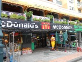 Ronald greets customers with a wai in Thailand