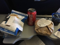 Well, United doesn't quite match the Air NZ food menu. Warm cheeseburger and some sort of pre-packed french fry crisps (which you have to but!)