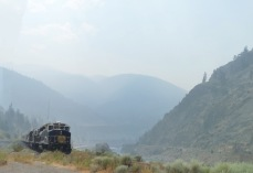 The Rocky Mountaineer looms out of the smoke